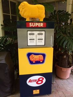 Fridge decorated as Golden Fleece petrol bowser/gas pump