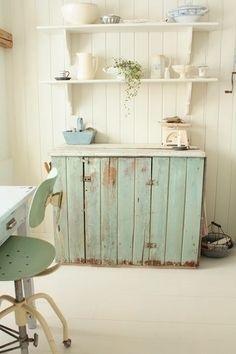 I want this little chest!  Love, love, love the color and the chippy paint.  It's my absolute favorite!
