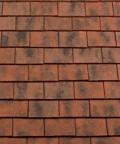 The Redland Rosemary Craftsman clay tile has a bespoke manufacturing process taht creates a gorgeous roof tile with a heritage look that maintains all the attributes and strength of a brand new tile.