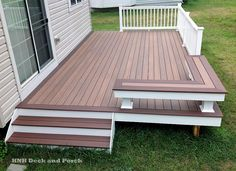 low maintenance decks, decks, outdoor furniture, outdoor living, Vinyl patio deck using Wolf PVC Decking with amberwood flooring and rosewood border and Longevity white PVC railing Low Deck Designs, Backyard Patio Designs, Pvc Decking, Composite Decking, Decking Material, Building A Porch, Diy Deck, House With Porch, House Deck
