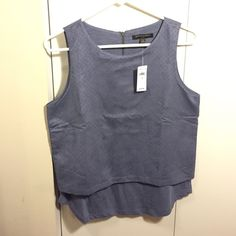 Banana Republic Tank Double Layer Tank by Banana Republic. Outer layer is a velvety material like the other side of a piece of leather. Inner layer is cotton material.  Zipper in the back. New with tags. Banana Republic Tops Tank Tops