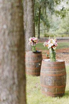 A Unique Twist On The Altar Using Whiskey Barrels And Flower Arrangements Countrywedding Weddingdecorrustic