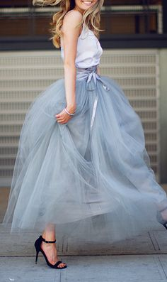 A tulle skirt is the latest on my list of must-have clothing items I want to obtain this year. Maybe a little shorter than this, but I love this color.