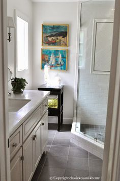 Small Bath Remodel at Classic Casual Home - like idea of all white walls, trim, tub tile and the dark slate floor tile for main bath with no windows.