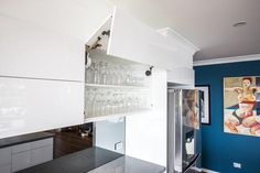 I like the over head cupboard that opens upwards