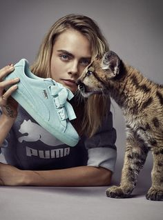 Cara Delevingne poses with PUMA Suede Heart Reset sneaker