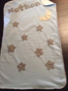 Light blue and cream fleece baby blanket with stars and a moon