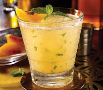 NEW PEACH HONEY SMASH Jack Daniel's Whiskey, Jack Daniel's Tennessee Honey, fresh mint, peach purée, citrus juices, peach slice