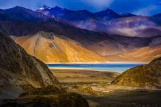 Ladakh, Pagong Lake. Love the tiny yellow house and its relation to the lake.