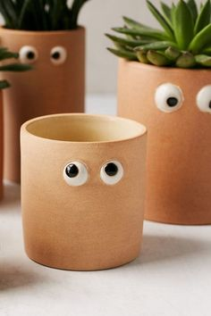 Shop Henry Googly Eye Small Planter at Urban Outfitters today. Face Planters, Indoor Planters, Diy Planters, Clay Planter, Garden Planters, Mini Vasos, Plant Crafts, Easy Plants To Grow, Painted Plant Pots