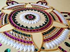 This is a beautiful Floor art from India made using Crystals on Clear thick plastic base. The design is a beautiful 7 piece one with a round