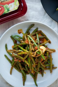 Matbucha green beans,  Just a little bit of Sabra's red Matbucha and you have this lovely dish