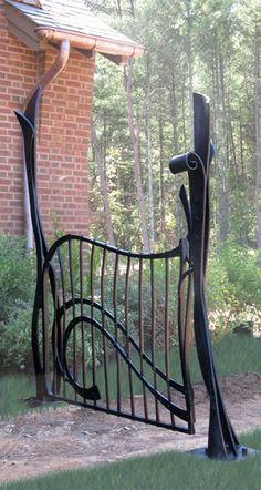 Very nice hand forged organic garden gate from Lynda Metcalfe in Brasstown, NC. Is she local to you?