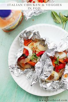 Italian Chicken and Vegetables In Foil - Flavorful and moist chicken breasts baked in foil with peppers, onion, garlic, fresh herbs and Italian Dressing.