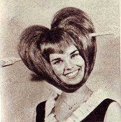 The Valentine's Day Hairdo Every Woman Should NOT Have. Check out the point in the bangs!