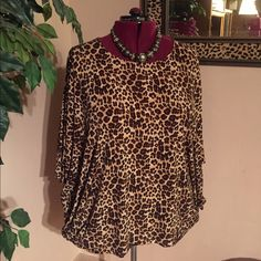 Chico's Leopard Skin Tunic Leopard skin tunic top. Scoop neck, ties at the sides or not. Three quarter length sleeves. Good quality fabric. Chico's Tops Tunics