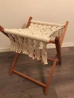 Macrame fringed seat on a vintage upcycled wooden camping stool, made from 3 ply cotton rope. Can also be used for a footstool. Measurements noted in photos. Will comfortably sit a child or adult up to 130 lbs. Folds up while not in use.