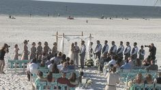 Processional of a wedding at the Hilton Clearwater Beach.  http://celebrationsoftampabay.com/videographers-clearwater-beach/