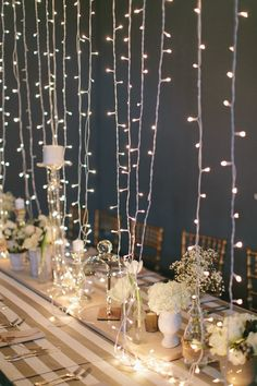 """Strong lights hanging from ceiling to middle of table makes a fun """"centerpiece"""" idea!"""