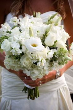 white wedding bouquet with green accents. #simple. #pure #elegant Photo Credit: samstroudphotography