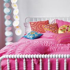The Jenny Lind bed from Land of Nod. Love the style! You can add side rails to keep the little ones from falling out, too.