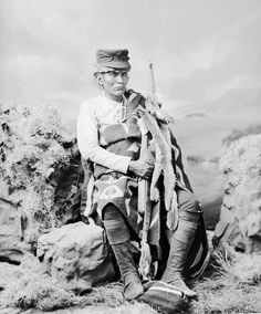 Chief Ganado Mucho (Much Cattle), Navajo, in Native Dress with Ornaments and Holding Bow - Bell - 1874