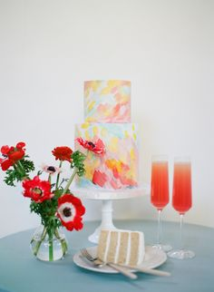 Red anemone and colorful painted wedding cake: http://www.stylemepretty.com/2016/11/15/colorful-wedding-day-inspiration/ Photography: Sylvie Gil - http://www.sylviegilphotography.com/