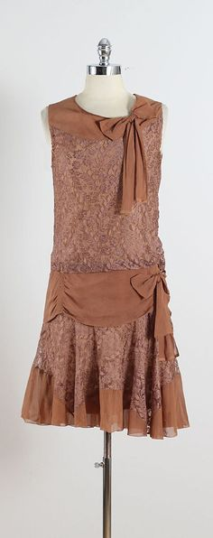➳ vintage 1920s dress  * brown silk crepe * brown floral lace * bow accents * drop waist * no side or back closure - pulls on over head  condition | excellent  fits like s/m  length 39 bodice 21 bust 38 waist 32  ➳ shop http://www.etsy.com/shop/millstreetvintage?ref=si_shop  ➳ shop policies http://www.etsy.com/shop/millstreetvintage/policy  twitter | MillStVintage facebook | millstreetvintage instagram | millstreetvintage  3636/1602