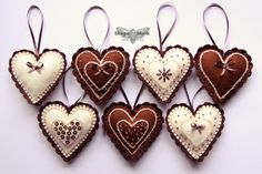 Heart shaped felt ornaments |  by ShapeMoth via Flickr ......... Crochet edge, Chain stitch, Beads and Ribbon