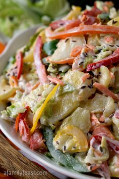 Sweet Bell Pepper Slaw with Pineapple - A delicious twist on the typical summer coleslaw recipe! You've got to try this recipe!