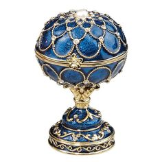 This exquisite enameled egg is skillfully rendered in the style made famous by Carl Faberg, the imperial jeweler for Russian nobility. A wax sculpture is made and cast in metal alloy using the traditi