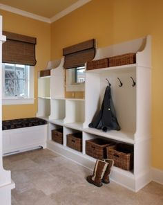 Mud room - I like the baskets beneath bench for shoes and those hooks hanging above.