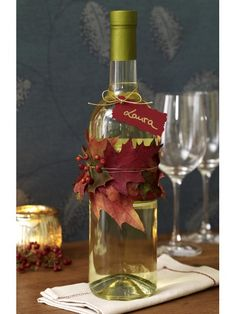 Autumn leaf wine bottle.  A nice way to display wine on a table at an Autumn party, or give as hostess gift.