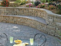 #Retainingwalls are often the perfect solution for uneven terrain.  This stone #patio - surrounded by a coordinating stone and paver-capped curved wall - gets extra seating from the bench formed by the curved two-tier wall structure.  For artistically-designed retaining walls in the Minneapolis MN area, contact us.
