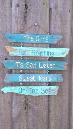 Driftwood Sign - Painted - The cure for anything is salt water, sweat, tears, or the sea. $34.99, via Etsy.