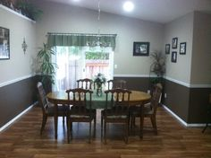 removed carpet and installed laminate flooring. All white walls now two toned with white chair rail, baseboard and door casings. Dark Blue Living Room, Dark Blue Walls, White Walls, Two Tone Walls, Installing Laminate Flooring, Dining Room Wainscoting, Chairs For Rent, Ashley Home, Dining Room Colors