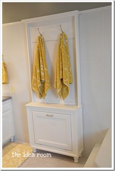 Hmmmm, base style, with mirror above instead... could be a stylized laundry chute in the bathroom