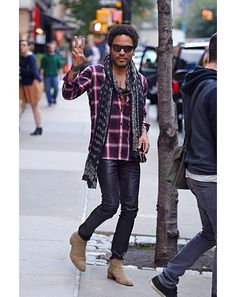 Lenny Kravitz in New York  Man, that's one long scarf. It just goes and goes…