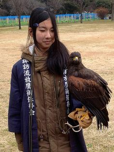 Falconry poses with a japanese girl by Allan Murphy.
