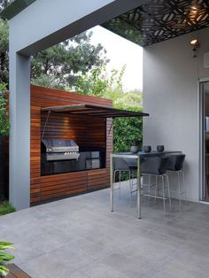 A custom-designed barbecue hutch made of spotted gum conceals appliances.