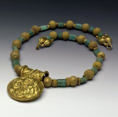 Bulla, Gold and Plasma Bead Necklace Century BC. © Trustees of the British Museum. Antique Necklace, Antique Jewelry, Vintage Jewelry, Beaded Necklace, Necklaces, Pendant Necklace, Ethnic Jewelry, Bead Jewelry, World Necklace