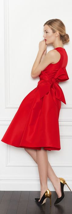 Carolina Herrera; Look at that bow. That's an occasion dress.