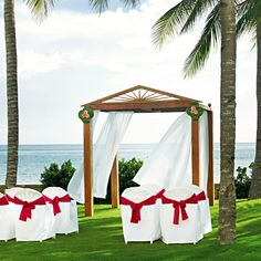 How dreamy is this beach wedding ceremony set up?!