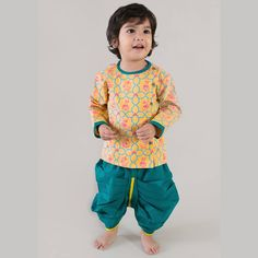 Revamp the traditional dhoti kurta set with original mouse print set. Fun, colorful and bright just like our little lad. Many more designs and colors available.