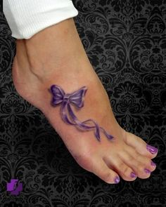 Well that is the sweetest little purple bow tattoo....especially with the purple toe nail polish! Love it!....that purp..