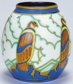 A Boch Freres earthenware Vase, depicting five falcons sitting on blue rocks done in matte enamels, circa 1901-1950