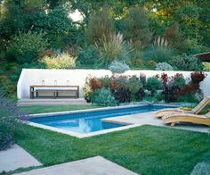 Elysian Landscapes - FLORAL CANYON On a sprawling hillside property, a series of intimate gathering spaces maximize the enjoyment and use of the land. A pair of large retaining walls are softened with dense layers of planting, making them virtually disappear.