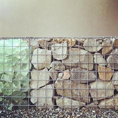 A fun gabion wall filled with rock and glass. Gabion Wall, Outdoor Walls, Landscape Design, Rock, Glass, Instagram Posts, Fun, Painting, Garden