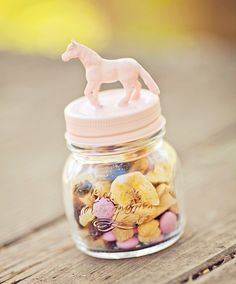 DIY horse topped mason jar - Spray paint lid w/glued figure on top. - Trail mix with party themed candy's