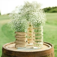 Table Centerpieces with baby's breath. I really love the vases - I may try this myself.